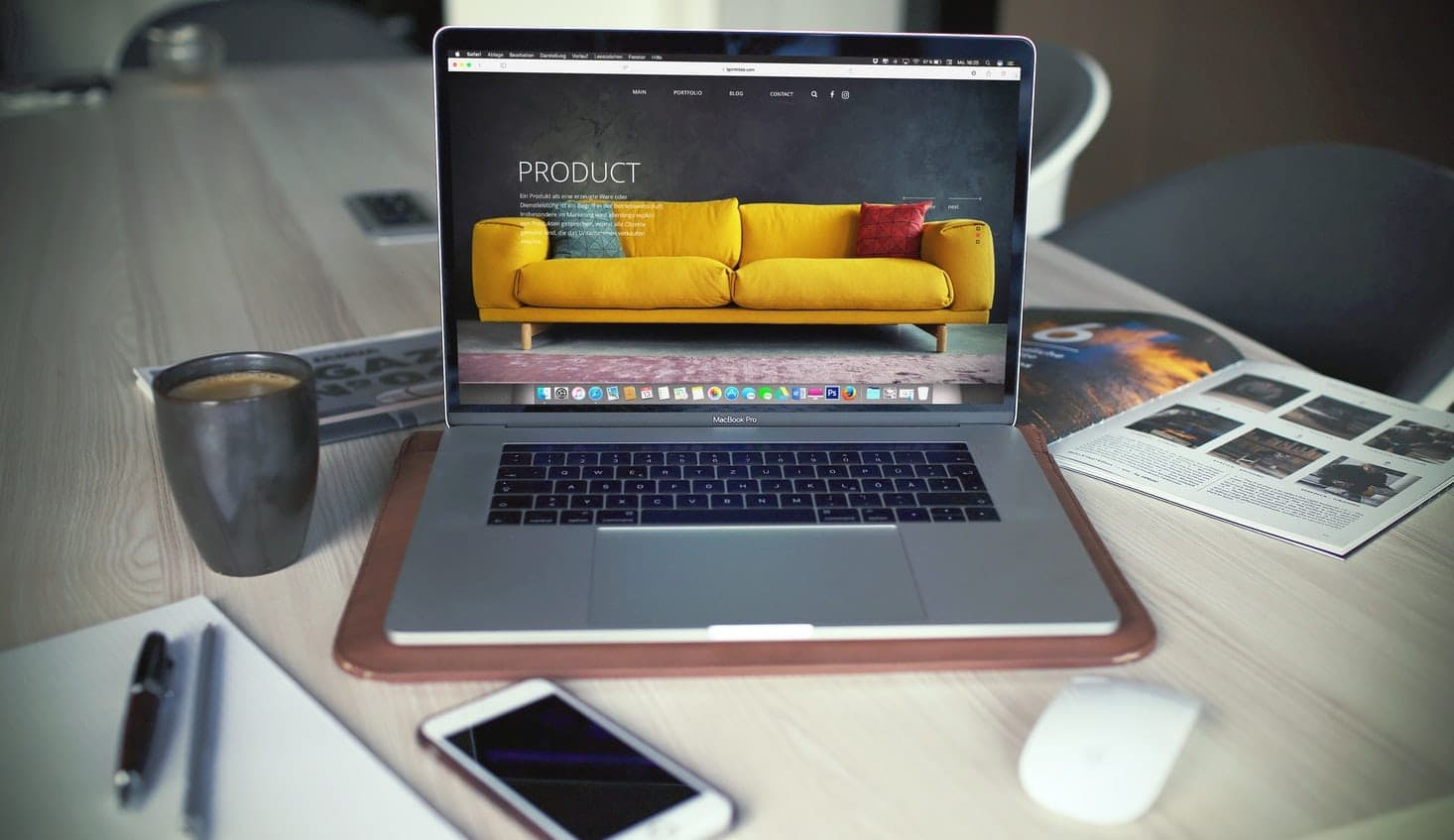 Apple Macbook and iPhone with website of sofa company